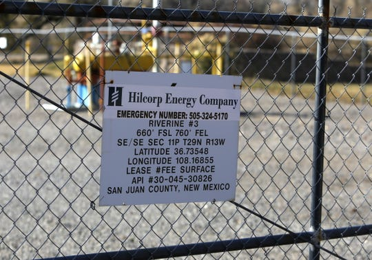 A sign on a fence displays the lease information for a well in Animas Park in Farmington operated by the Hilcorp Energy Company.
