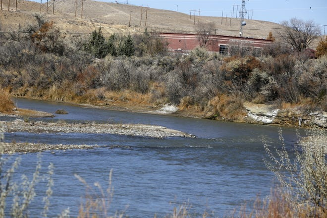 The San Juan River flows Friday in Westland Park in Farmington. If the water level in Lake Powell drops below a certain point, it could impact funding for a program that protests habitat for endangered fish in the San Juan River.