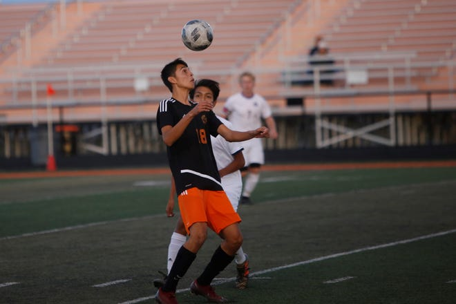 Aztec's Francisco Villegas receives the ball against Kirtland Central during a District 1-4A match on Oct. 25 at Fred Cook Stadium in Aztec. Villegas is among five AHS players to receive first All-District team honors.