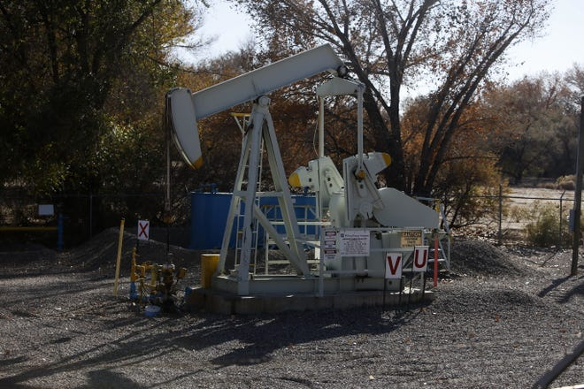 A pump jack owned by Hilcorp operates Fridayin Animas Park in Farmington.