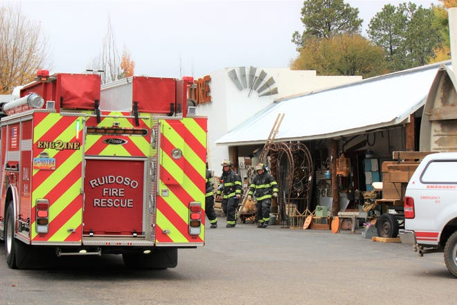 Ruidoso firefighters exit the Re-Store shop at 2200 Sudderth Drive after a chimney fire had been extinguished around 11:00 a.m.