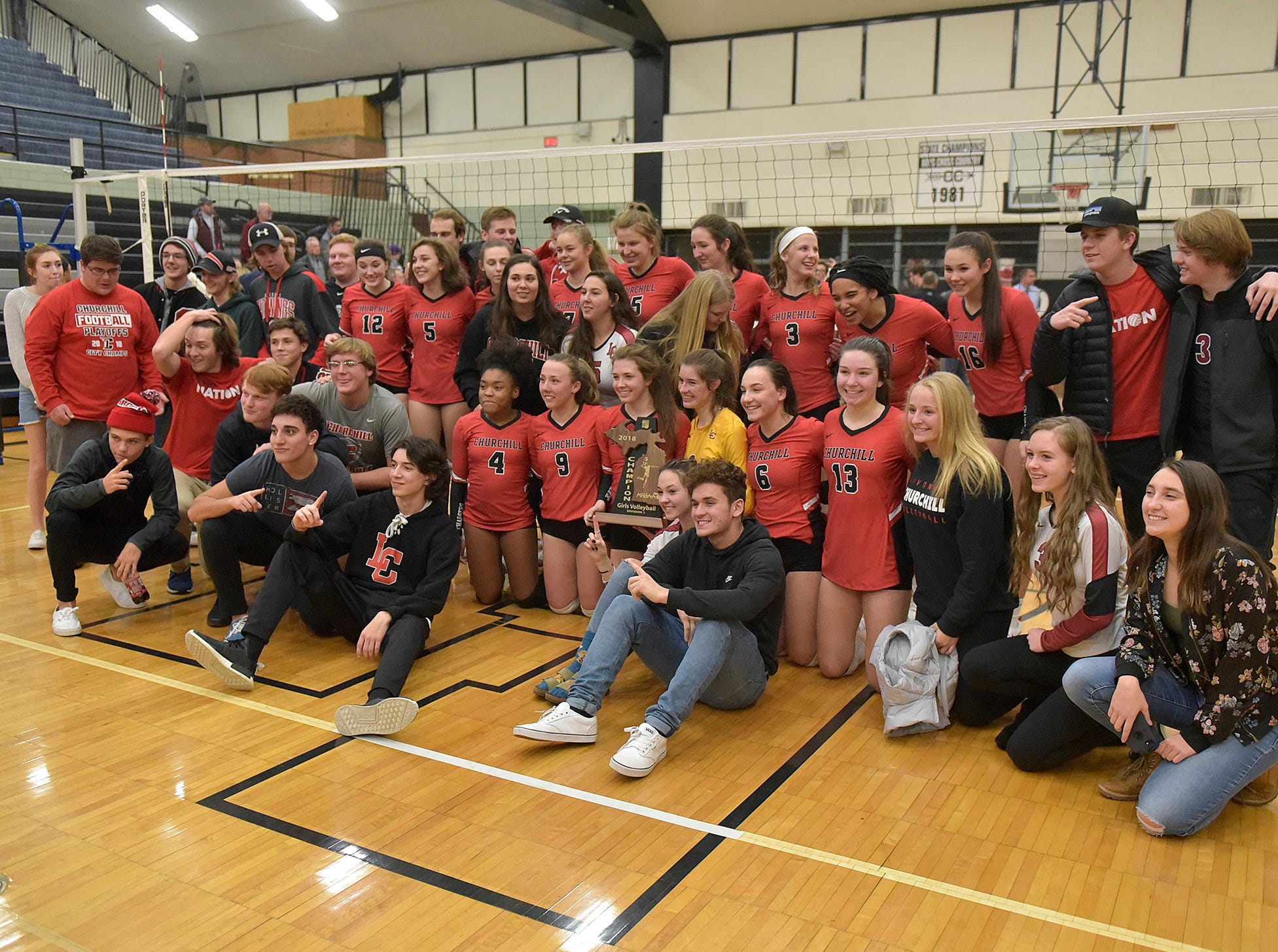 Livonia Churchill volleyball and fans.