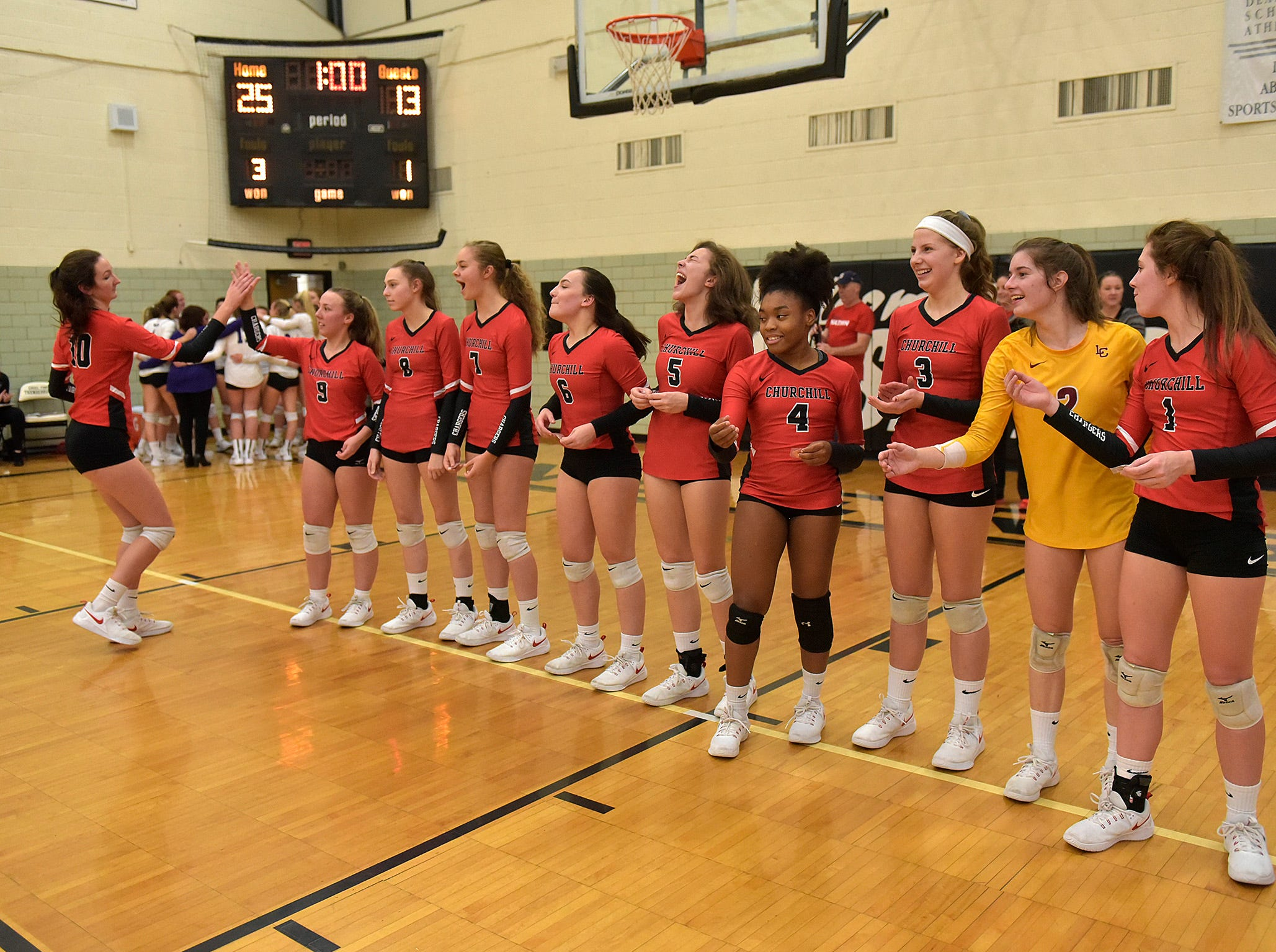 Churchill receives their medals. In the background, Woodhaven gathers after the loss.