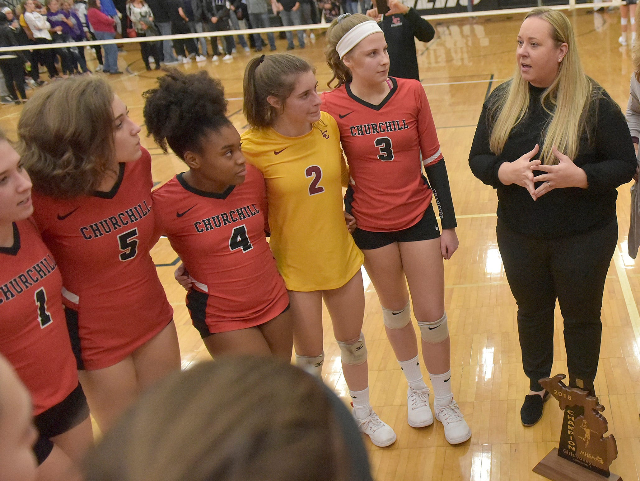Coach Kristin Clutter speaks to her team after the victory.