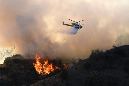 Flames from a wildfire burn a portion of Griffith Park in Los Angeles, California, November 9, 2018. - Staff at the Los Angeles Zoo, which is located in the park are preparing animals to be evacuated. (Photo by Robyn Beck / AFP)        (Photo credit should read ROBYN BECK/AFP/Getty Images)