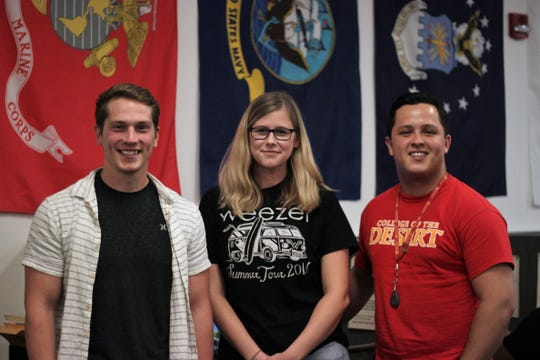 Travis McCarty, Jenna Belt and Armando Robles, three Marine veterans who chose to pursue a college education after military service.