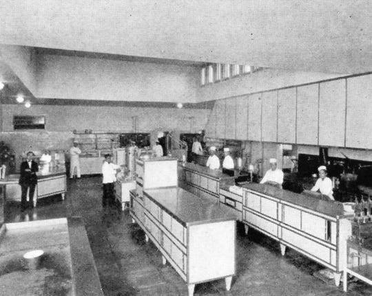 Rare view of the interior of the kitchen of the Desert Inn with cooks.