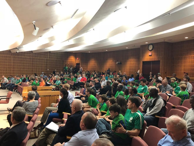 Youth soccer players and parents fill the Pensacola City Council chambers to support a proposed land swap deal for a youth soccer complex on Thursday, Nov. 8, 2018.