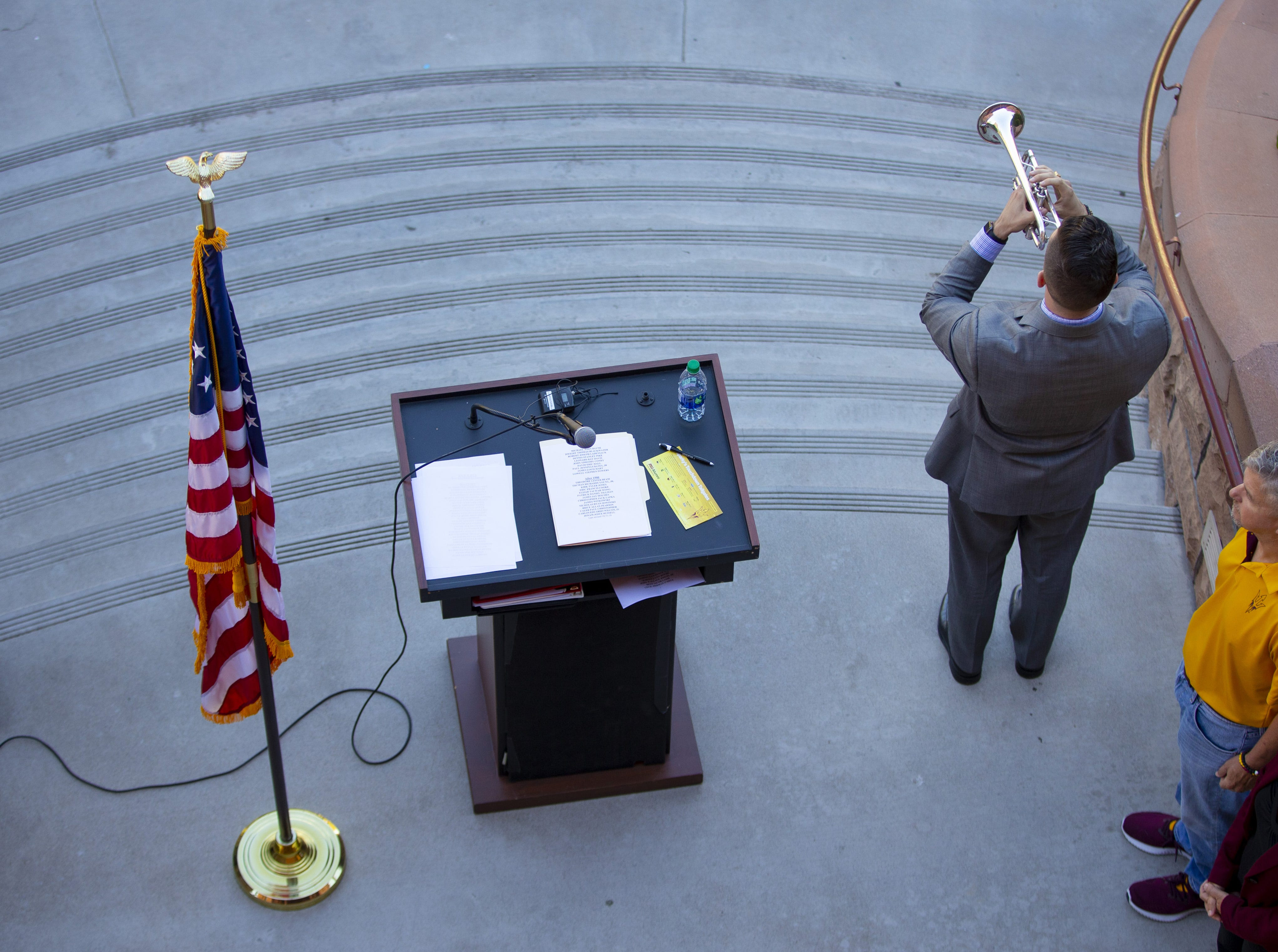 ASU student Aaron Lovelady plays Taps after the reading of names of a 137 ASU Alumni who died while serving their country during an annual tradition on the Tempe campus.
