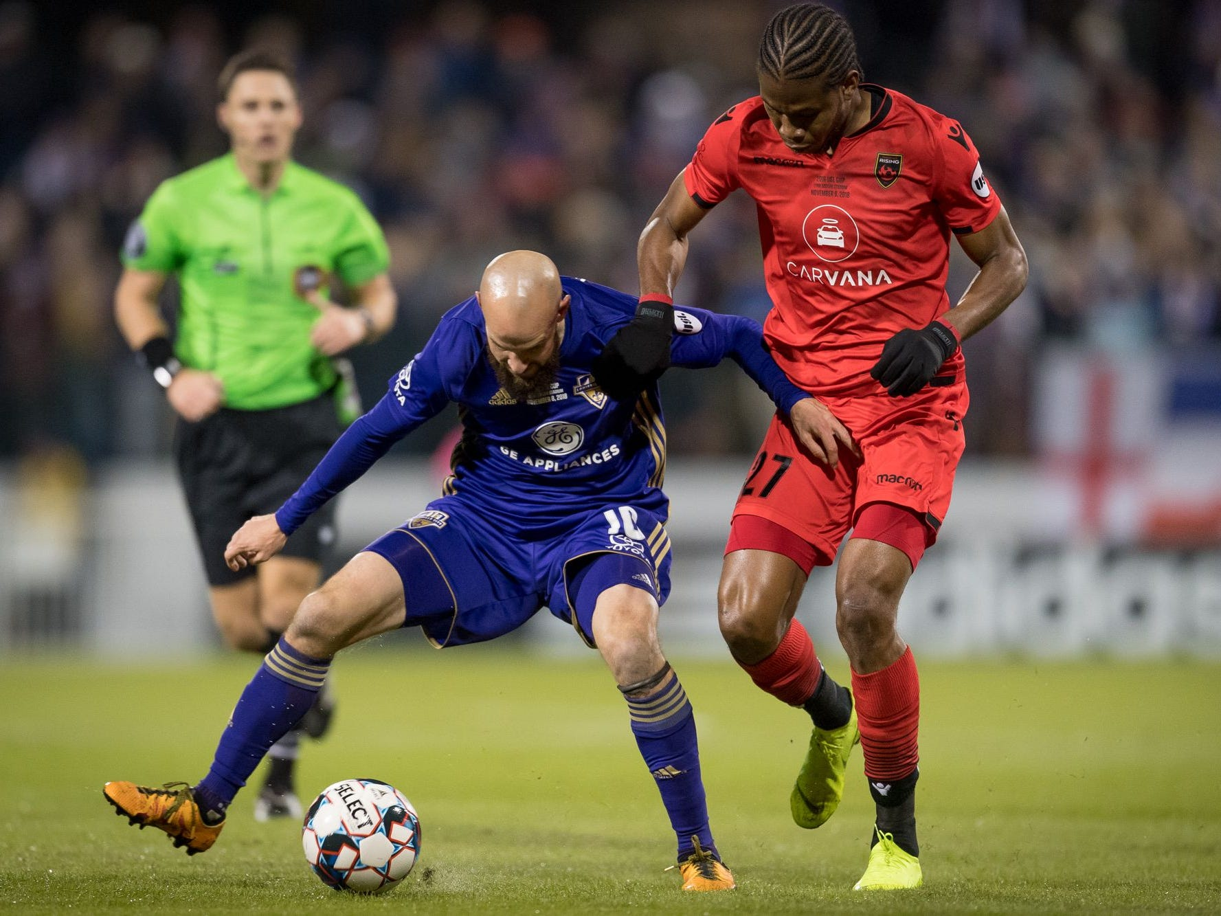 Louisville City FC midfielder Brian Ownby (10) plays against Phoenix Rising FC midfielder Kevon Lambert (27) during the first half of the USL Cup final played at Lynn Stadium on the campus of the University of Louisville, Louisville, Ky., Thursday, Nov., 8, 2018.