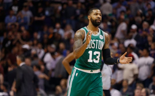 Celtics Marcus Morris (13) celebrates after they beat the Suns in overtime at Talking Stick Resort Arena in Phoenix, Ariz. on November 8, 2018.