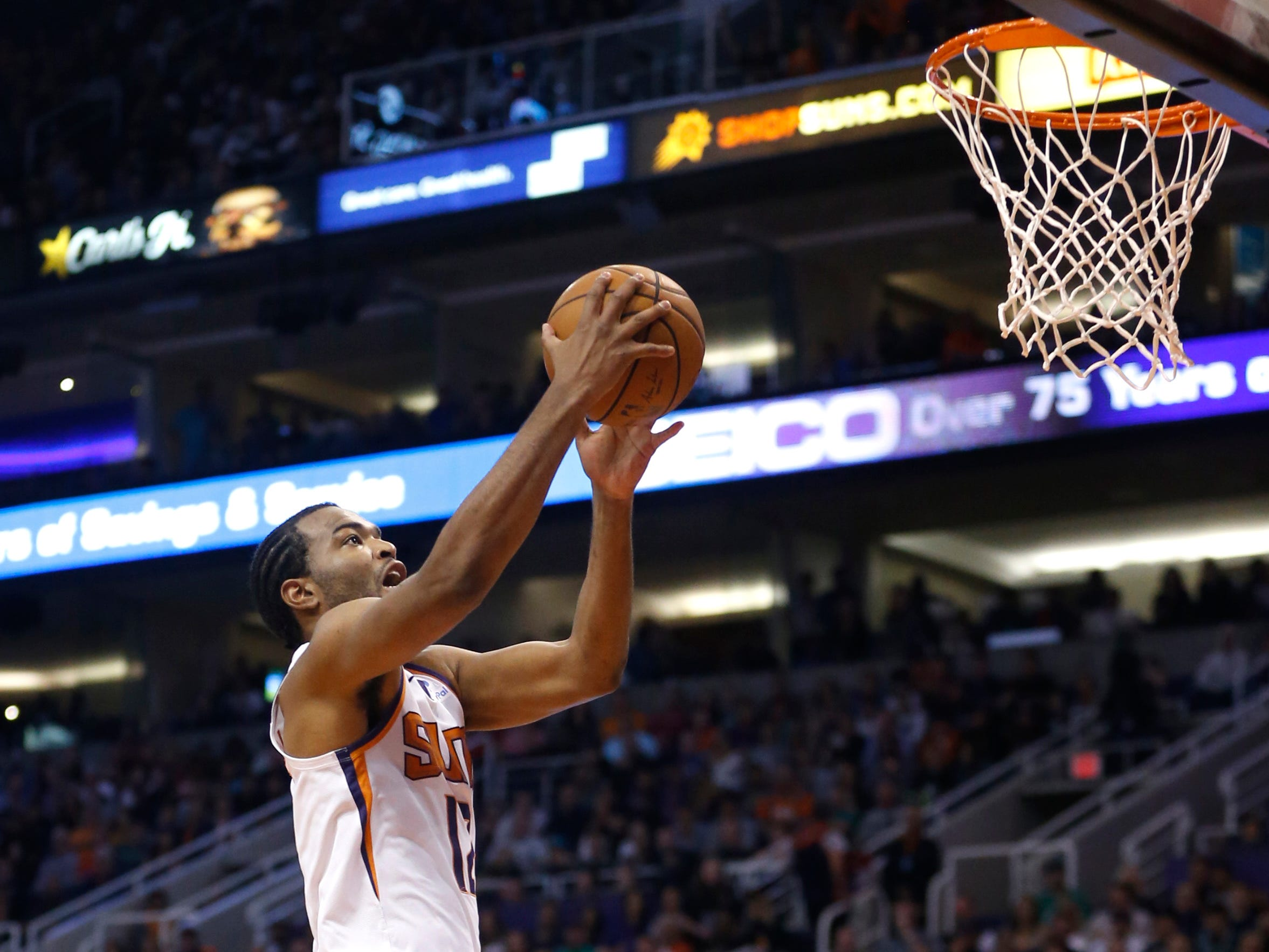 Suns' TJ Warren (12) makes a layup against the Celtics during the first half at Talking Stick Resort Arena in Phoenix, Ariz. on November 8, 2018.
