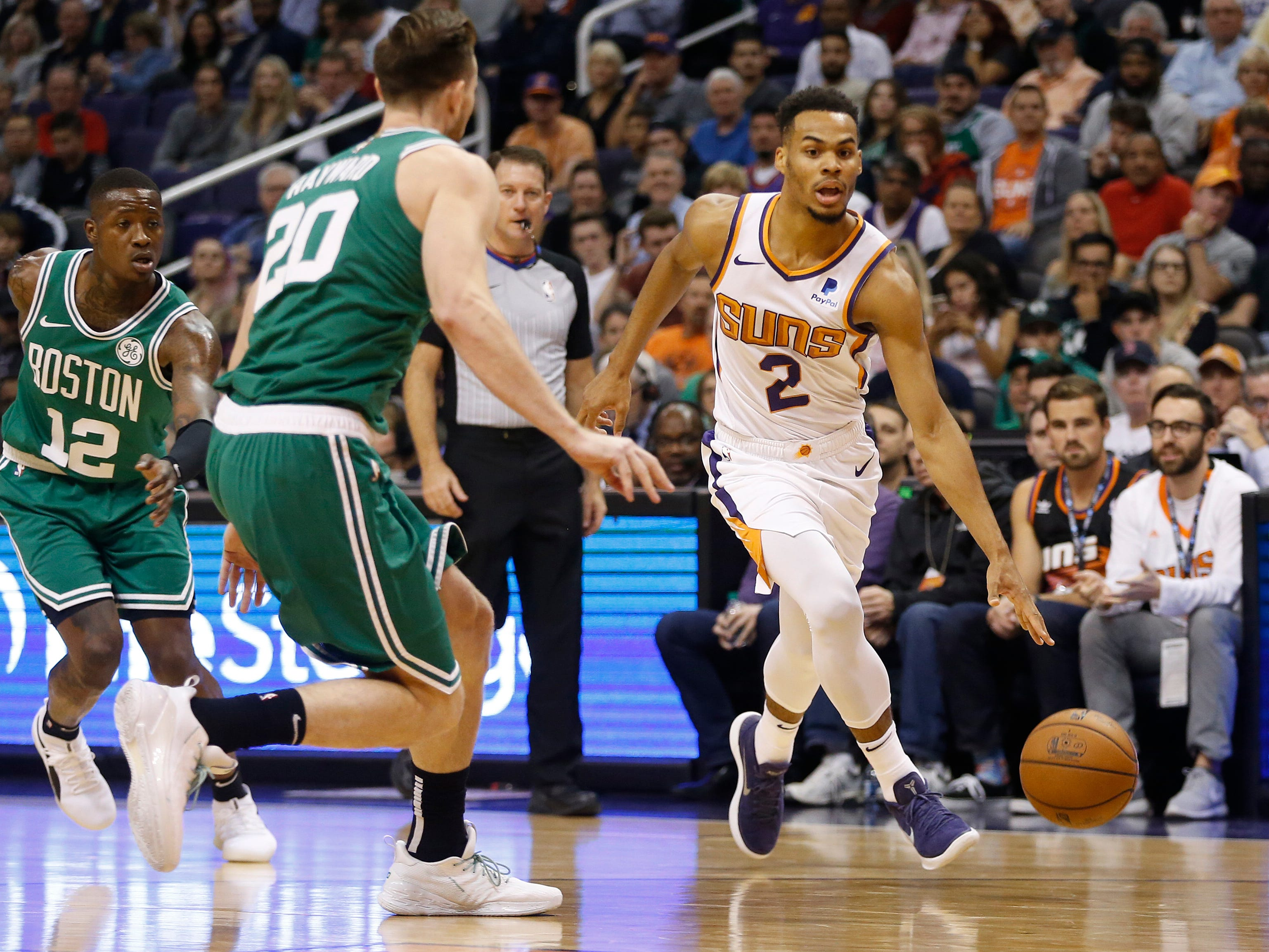 Suns' Elie Okobo (2) drives against the Celtics' Gordon Hayward (20) during the first half at Talking Stick Resort Arena in Phoenix, Ariz. on November 8, 2018.