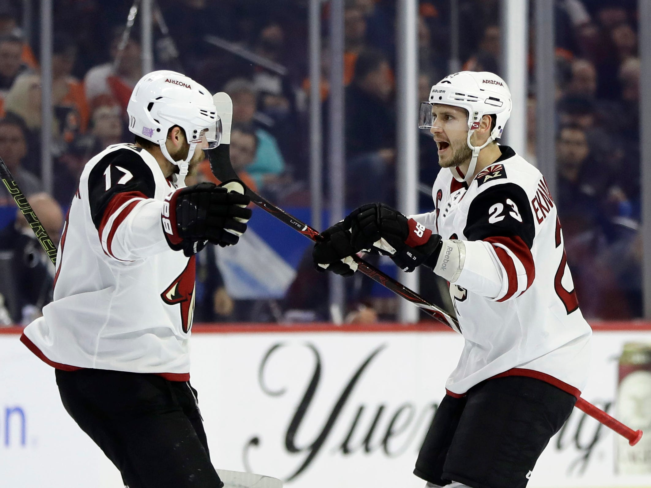 Arizona Coyotes' Oliver Ekman-Larsson, right, and Alex Galchenyuk celebrate after Ekman-Larsson's goal against the Philadelphia Flyers during the first period of an NHL hockey game, Thursday, Nov. 8, 2018, in Philadelphia. (AP Photo/Matt Slocum)
