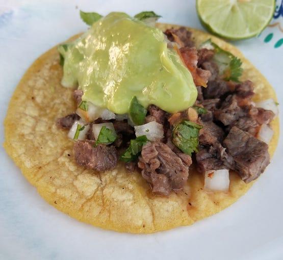 The carne asada taco with homemade salsa at Tacos Tijuana.