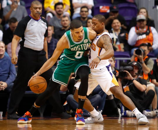 Celtics' Jayson Tatum (0) backs down Suns' Isaiah Canaan (0) during the first half at Talking Stick Resort Arena in Phoenix, Ariz. on November 8, 2018.