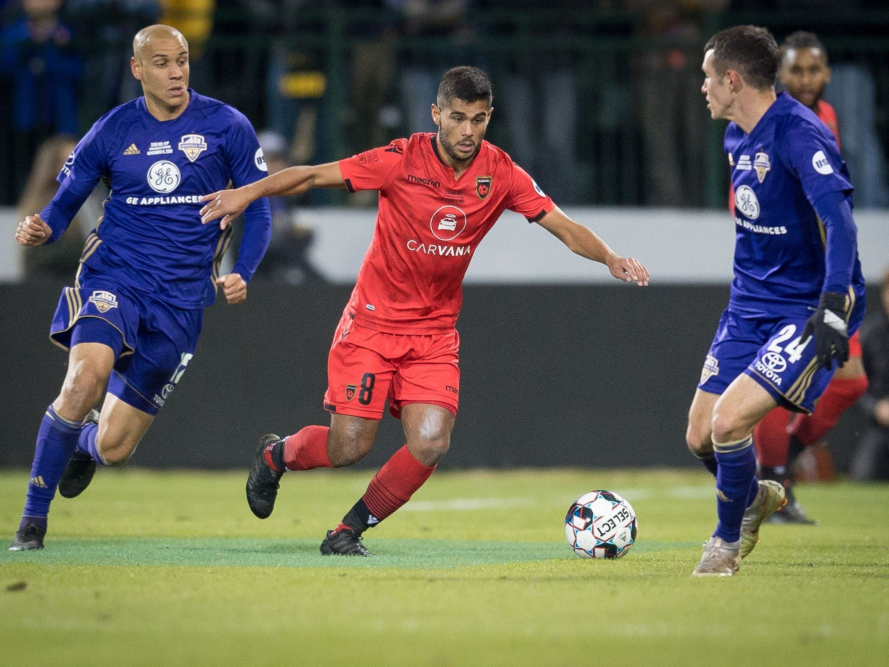 Phoenix Rising FC midfielder Collin Fernandez (8) is trapped between Louisville City FC midfielder Kyle Smith (24) and forward Luke Spencer (12) during the USL Cup final played at Lynn Stadium on the campus of the University of Louisville, Louisville, Ky., Thursday, Nov., 8, 2018.