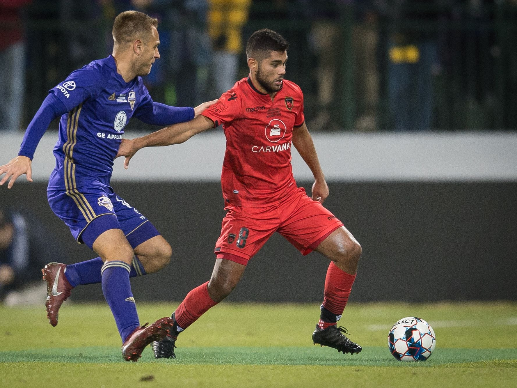 Phoenix Rising FC midfielder Collin Fernandez (8) plays against Louisville City FC forward Ilija Ilić (14) during the USL Cup final played at Lynn Stadium on the campus of the University of Louisville, Louisville, Ky., Thursday, Nov., 8, 2018.