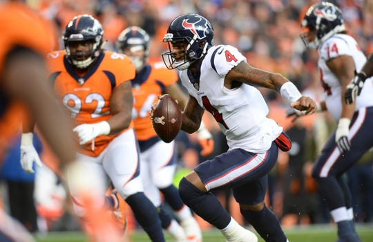 Texans quarterback Deshaun Watson scrambles during the first quarter of a game against the Broncos on Nov. 4 at Broncos Stadium at Mile High.