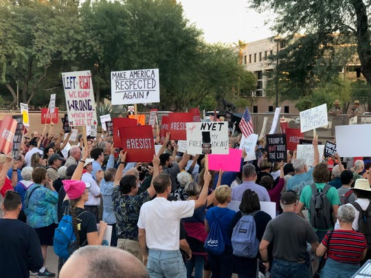 Protesters gathered at the Arizona State Capitol to support the Robert Mueller investigation.