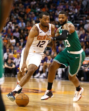 TJ Warren drives against Celtics forward Marcus Morris during the first half of a game Thursday at Talking Stick Resort Arena.