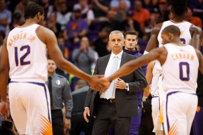 Suns coach Igor Kokoskov watches his team head back to the bench during the first half of a game against the Celtics at Talking Stick Resort Arena.