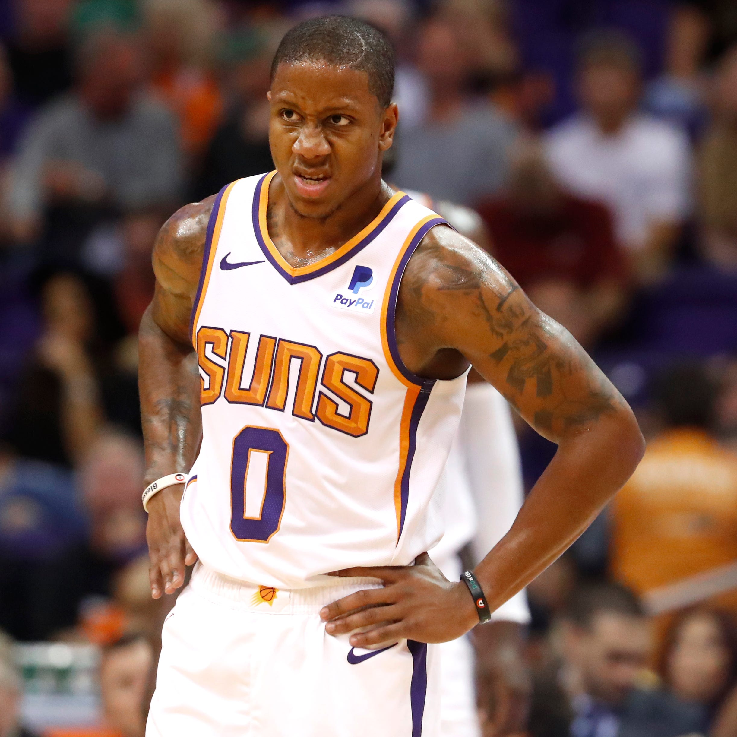 Suns' Isaiah Canaan (0) waits for a timeout to end against the Celtics during the first half at Talking Stick Resort Arena in Phoenix, Ariz. on November 8, 2018.