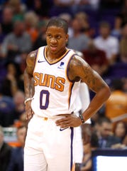 Isaiah Canaan waits for a timeout to end during the Suns' overtime loss to the Celtics on Thursday at Talking Stick Resort Arena.