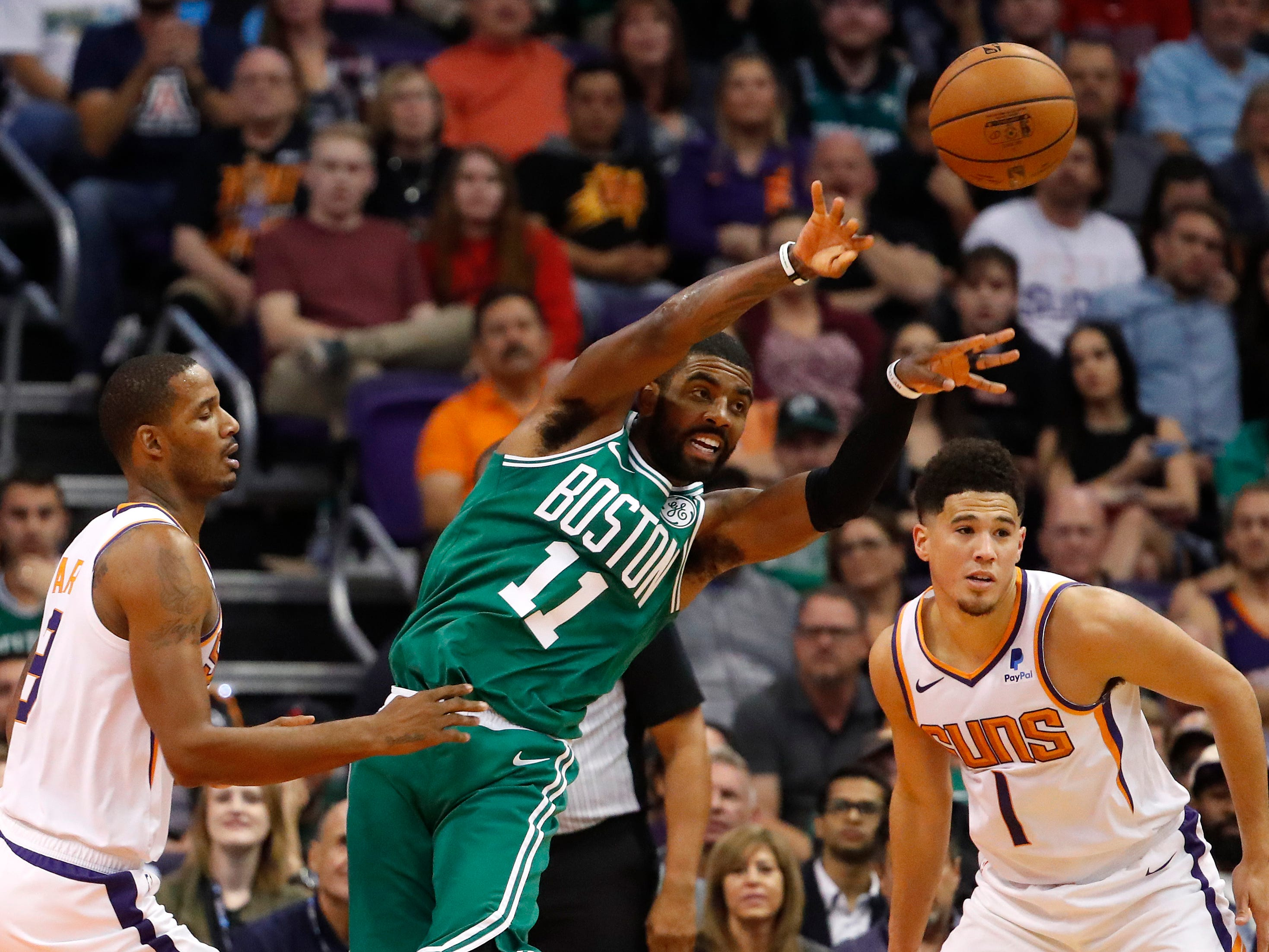Suns' Trevor Ariza (3) defends Celtics' Kyrie Irving (11) during the first half at Talking Stick Resort Arena in Phoenix, Ariz. on November 8, 2018.