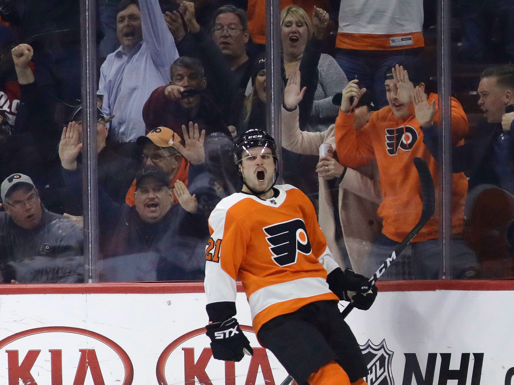 Philadelphia Flyers' Scott Laughton celebrates after scoring a goal during the third period of an NHL hockey game against the Arizona Coyotes, Thursday, Nov. 8, 2018, in Philadelphia. Philadelphia won 5-4 in overtime. (AP Photo/Matt Slocum)