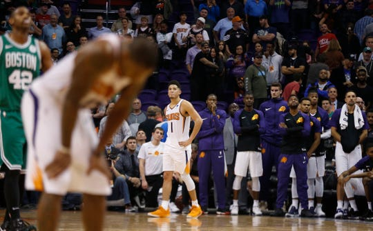 Devin Booker had a season-high 38 points, but the Suns fell short against he Celtics in overtime 116-109.