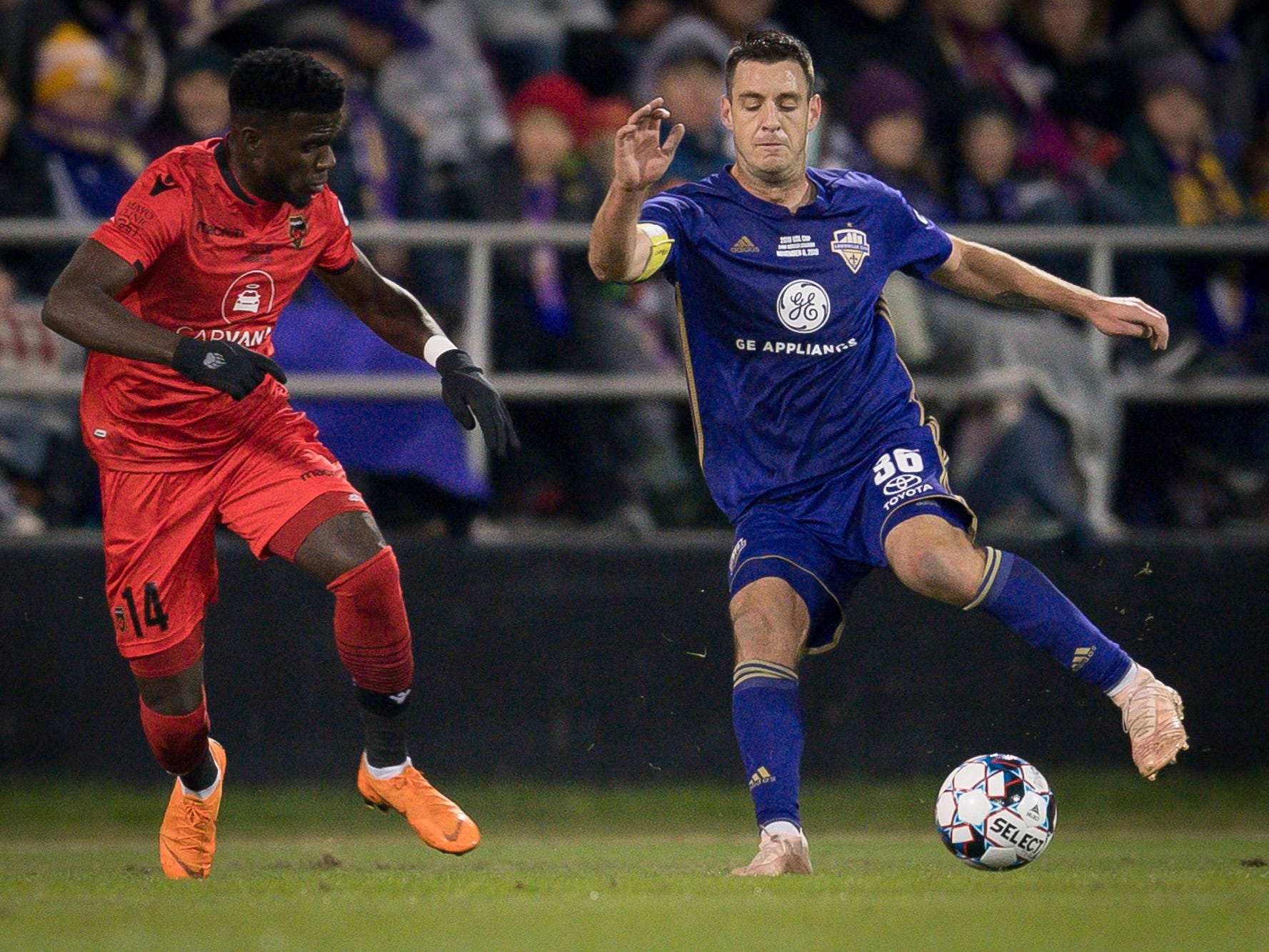 Louisville City FC midfielder Paolo DelPiccolo (36) plays against Phoenix Rising FC forward Jason Johnson (14) during the first half of the USL Cup final played at Lynn Stadium on the campus of the University of Louisville, Louisville, Ky., Thursday, Nov., 8, 2018.