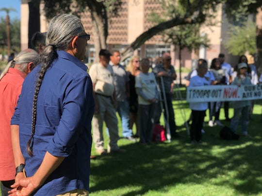 A group of Arizona residents from rural  border towns stood behind the podium at the event.