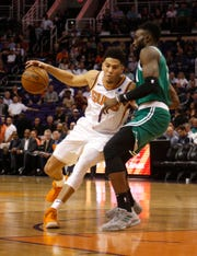 Devin Booker drives to the basket against Celtics guard Jaylen Brown during the first half of a game Nov. 8.