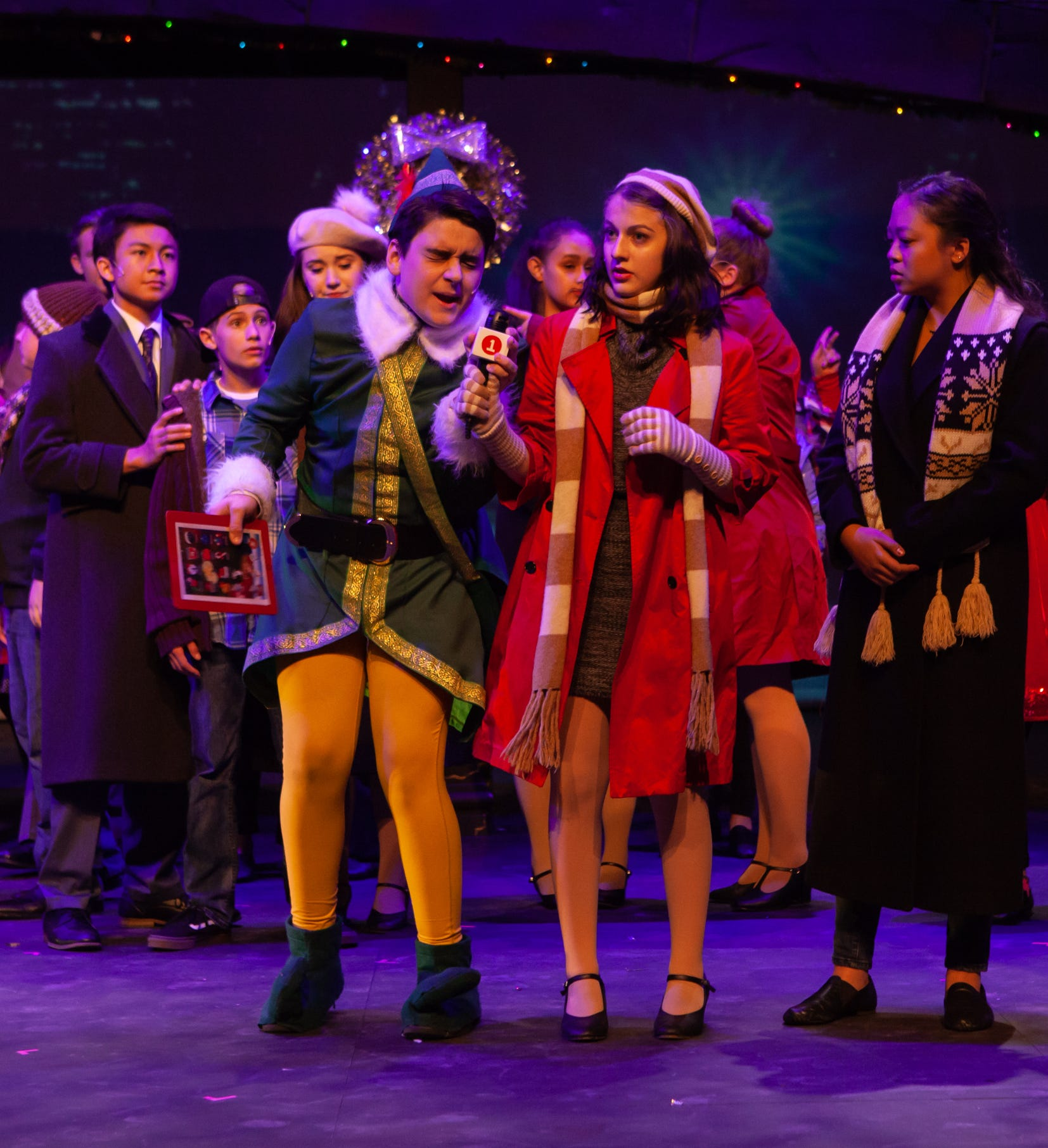 Josh Pike (front left, as Buddy the Elf) and Kendra Goodenberger (Charlotte Dennon)
