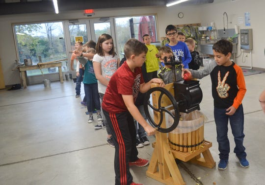 All of the Woodmore students had the chance to feed and turn the apple press  during their Oct. 31 field trip to Creek Bend Farm. Last year, about 3,700 area students visited the farm.