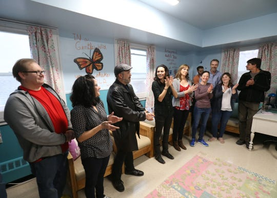 Hilarie Burton applauds the group of volunteers that helped renovate a residential unit at Astor Services in Rhinebeck on November 9, 2018.