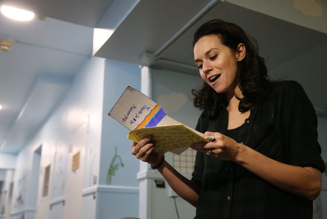 Hilarie Burton reads a thank you letter from one of the children that lives on a residential unit at Astor Services that Burton organized a renovatio of in Rhinebeck on November 9, 2018.
