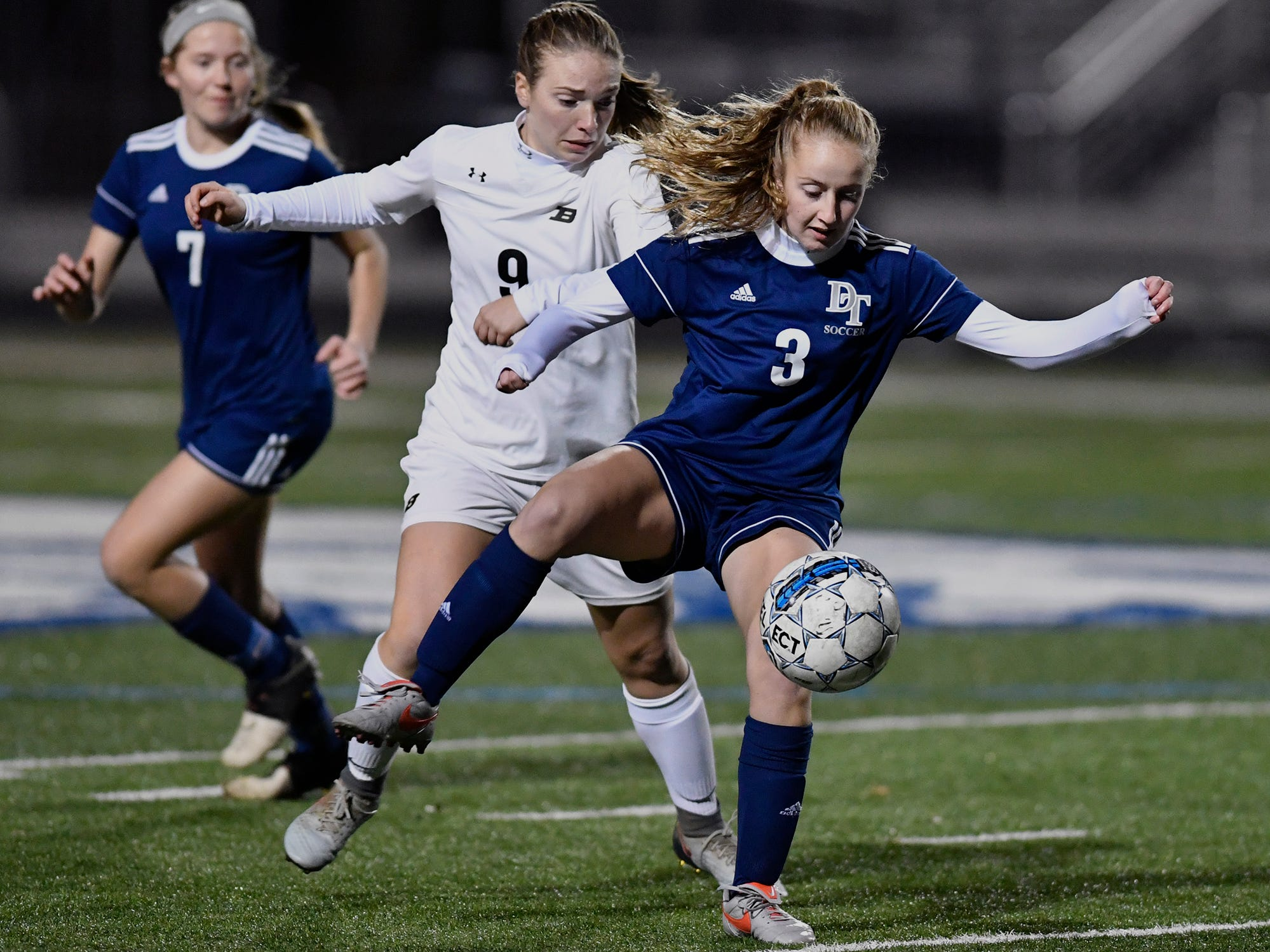 Caroline Muth of Dallastown blocks out Carly Stoner of Biglerville to control the ball during the York-Adams League Girls' Soccer Senior All-Star Game, Thursday, November 7, 2018. John A. Pavoncello photo