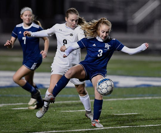 Caroline Muth of Dallastown blocks out Carly Stoner of Biglerville to control the ball during the York-Adams League Girls' Soccer Senior All-Star Game, Thursday, November 7, 2018. 