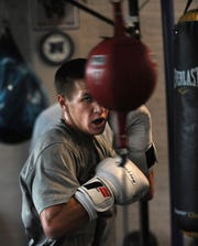 Nevada boxer Davis Ault, grandson of Chris Ault, works out at Nevada Boxing in Reno on Nov. 7.