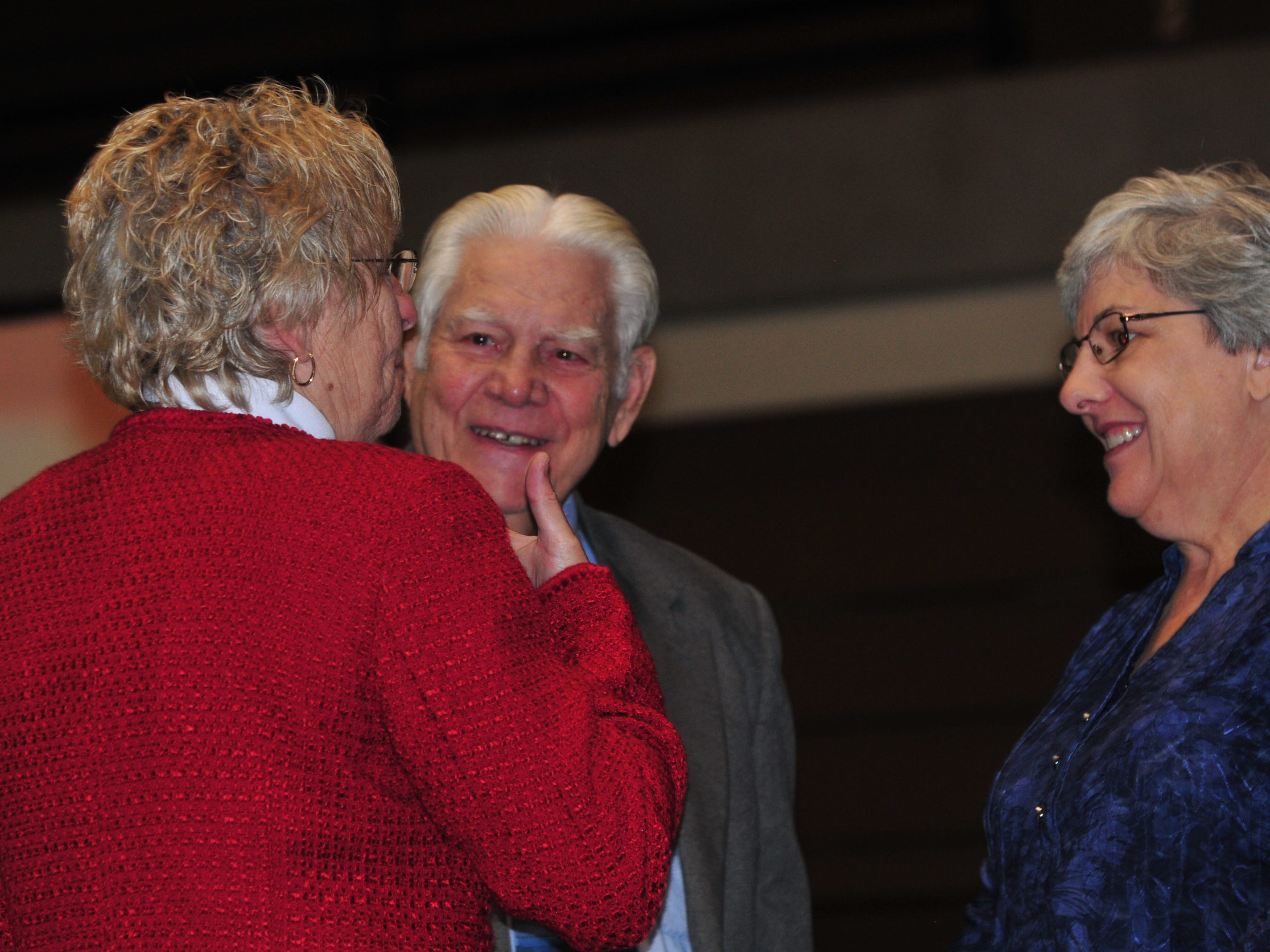 Bill Grimes speaks with Richmond High School Principal Rae Woolpy after Grimes received a diploma during Friday's Veterans Day Program.