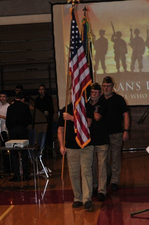 Veterans of Foreign Wars members present the colors during a past Veterans Day Program at Richmond High School.