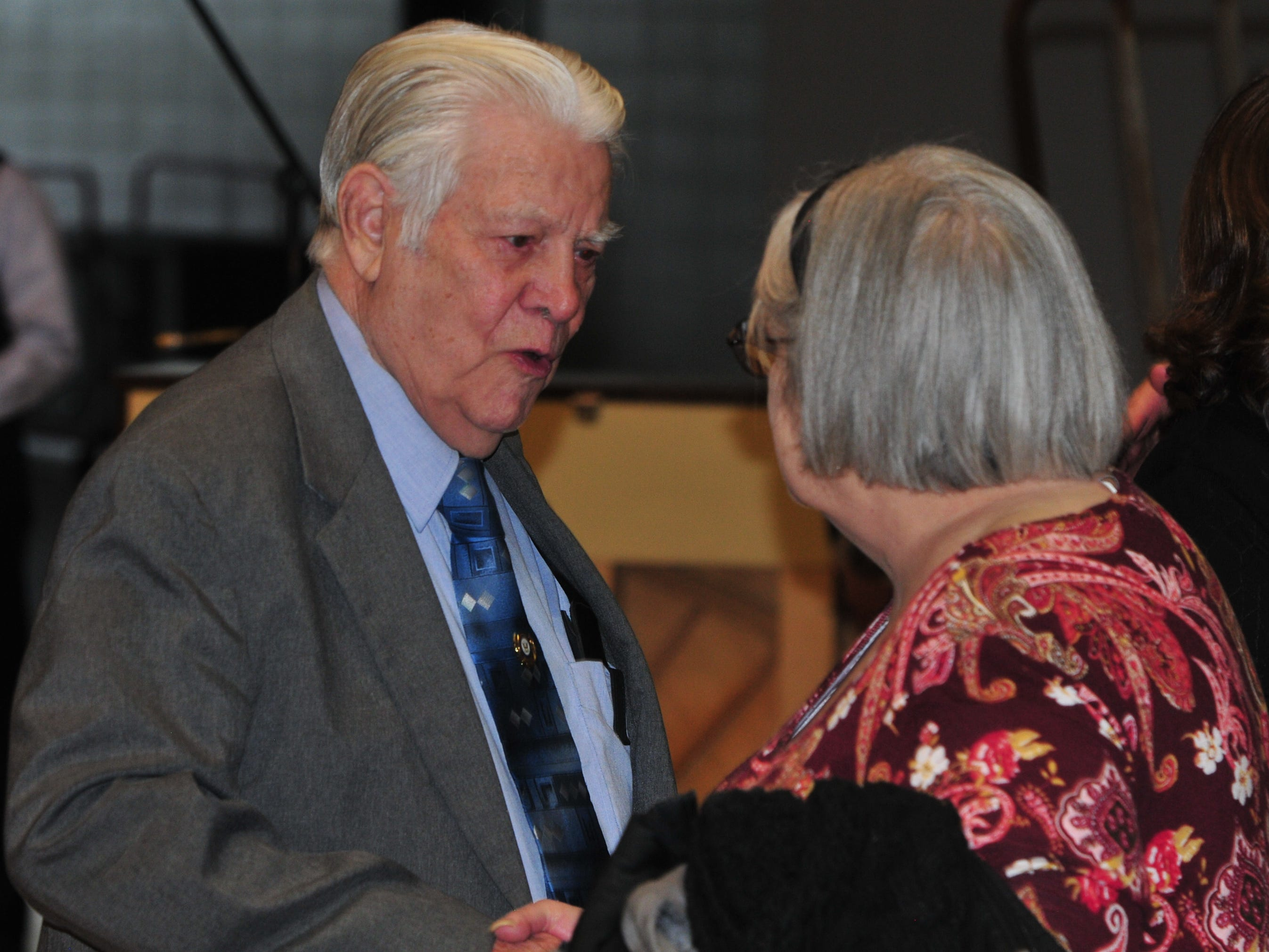 Bill Grimes receives congratulations after he received a diploma during Friday's Veterans Day Program at Richmond High School.