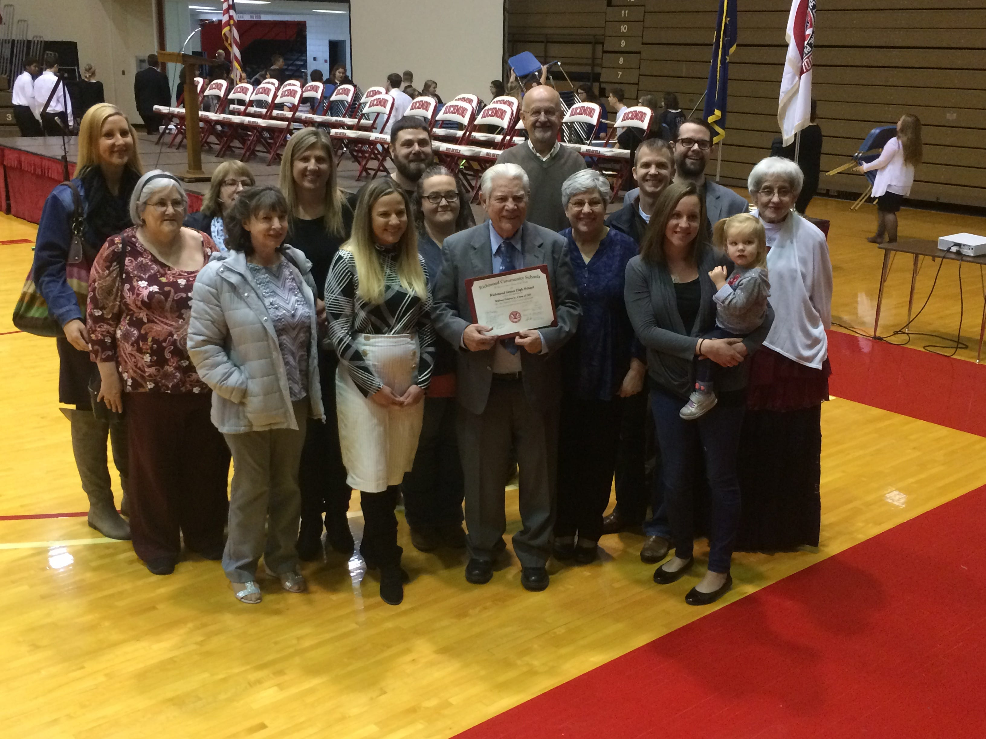 Family members pose with Bill Grimes after he received a diploma Friday during Richmond High School's Veterans Day Program. Grimes daughter, Kathy Dudas (far right), pursued the diploma for her father.
