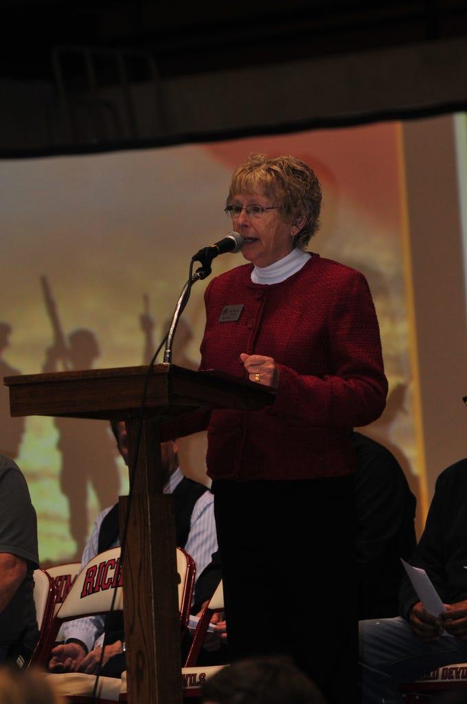 Richmond High School Principal Rae Woolpy opens Friday's Veterans Day Program in Tiernan Center.