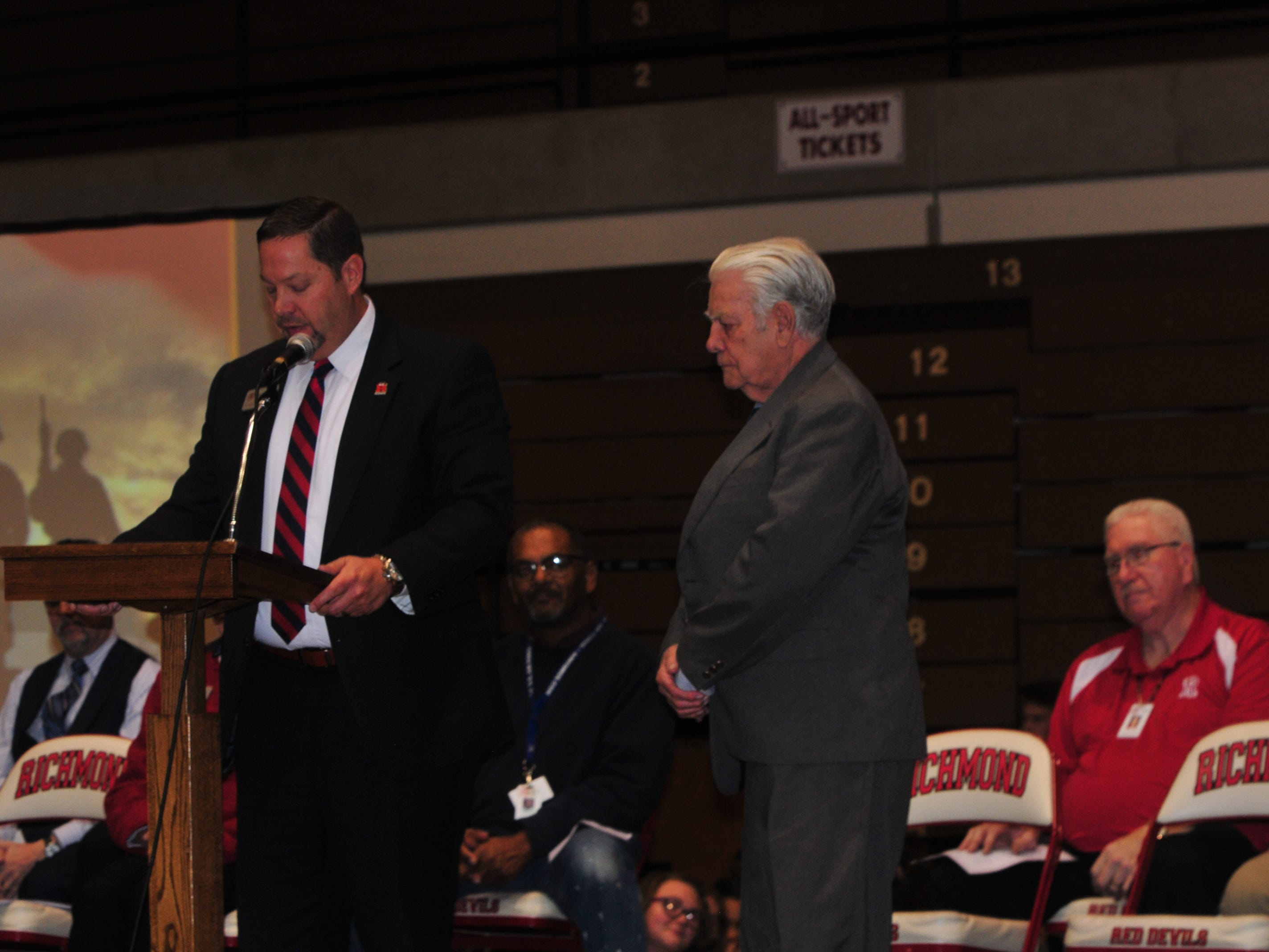 Richmond Community Schools Superintendent Todd Terrill awards a Richmond High School diploma to Bill Grimes, who left RHS to join the Navy.