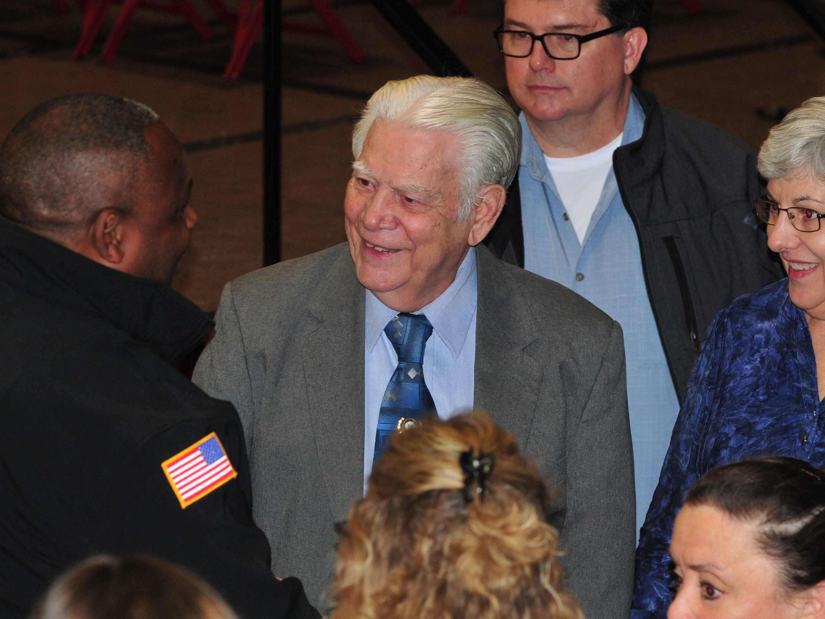 Bill Grimes receives congratulations from school board member Aaron Stevens after Grimes received a diploma during Friday's Veterans Day Program at Richmond High School.
