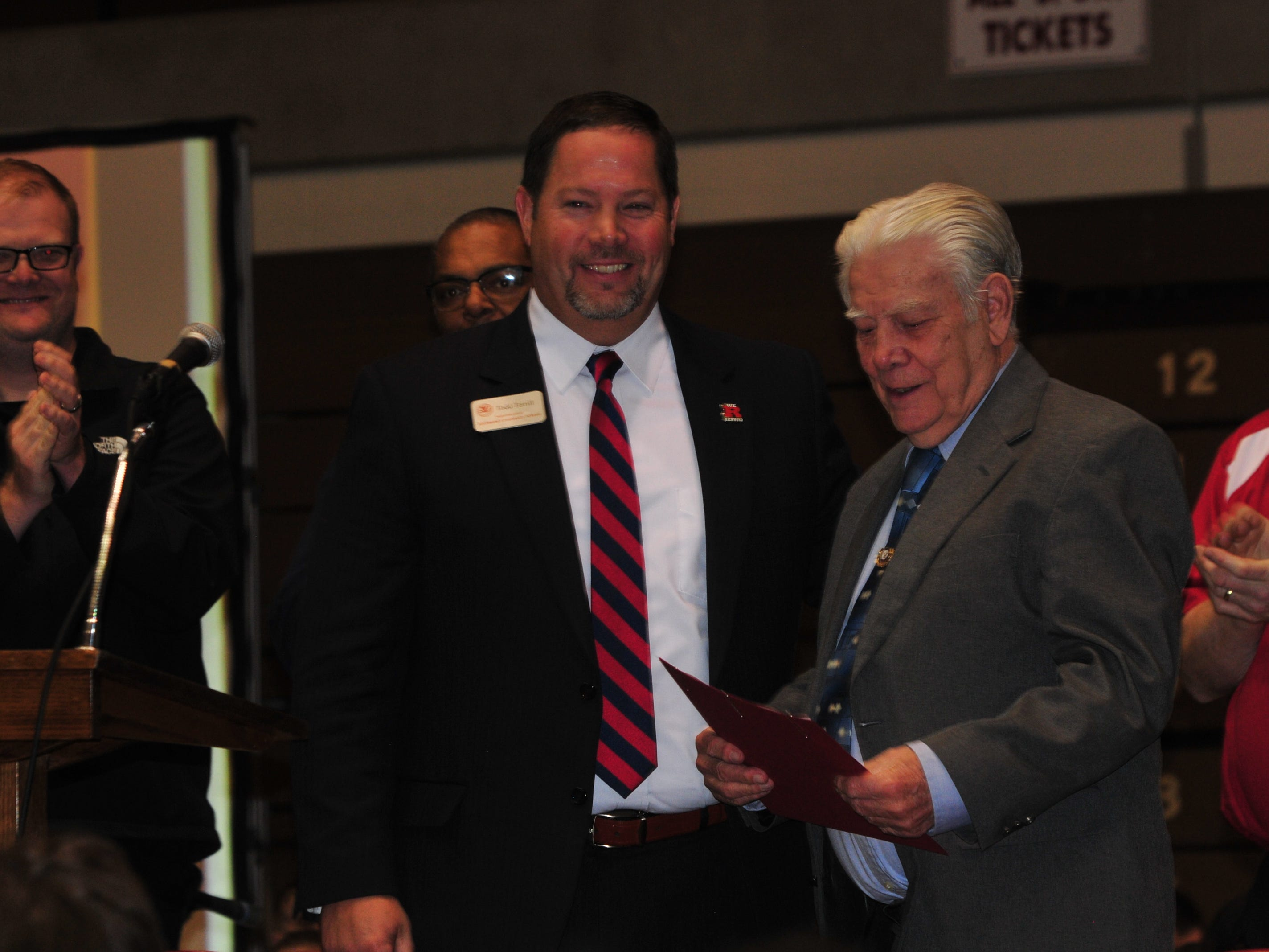 Bill Grimes looks at his Richmond High School diploma after receiving it from Richmond Community Schools Superintendent Todd Terrill during Friday's Veterans Day Program.