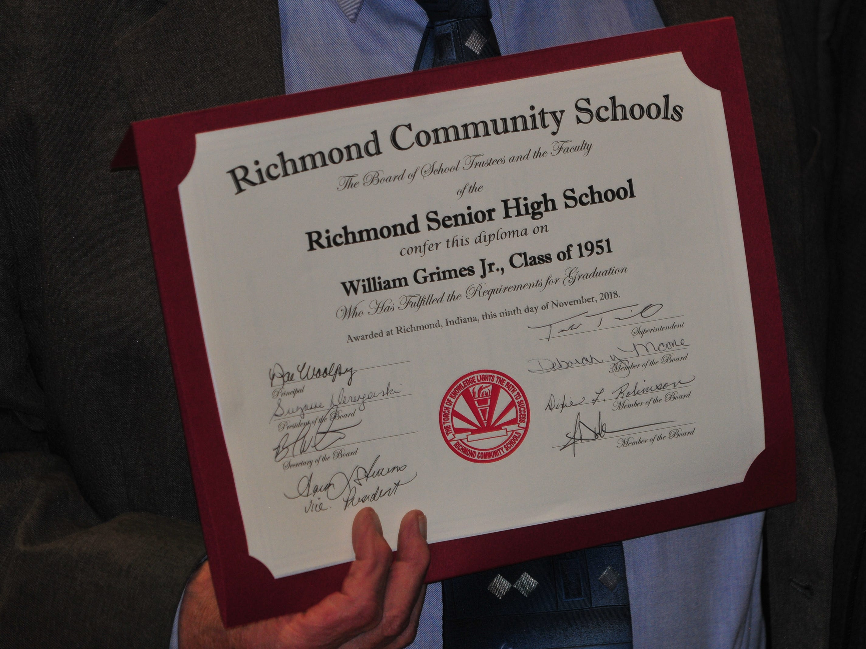 Bill Grimes received a diploma during Friday's Veterans Day Program at Richmond High School.